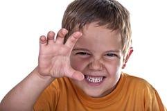 Grimacerie de l'enfant de sourire Photo libre de droits