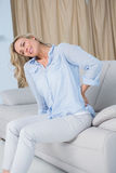 Grimacing blonde getting back pain Royalty Free Stock Photo