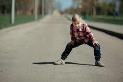 Grimacing boy outdoors portrait Stock Image