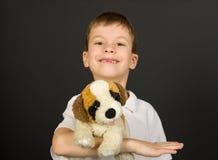 Grimacing boy portrait on black Royalty Free Stock Images