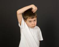 Grimacing boy portrait on black Stock Images