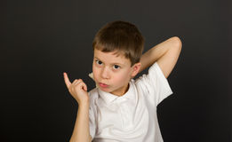 Grimacing boy portrait on black Royalty Free Stock Image
