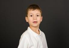 Grimacing boy portrait on black Royalty Free Stock Photography