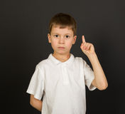 Grimacing boy portrait on black Royalty Free Stock Photo