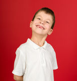 Grimacing boy portrait on red Royalty Free Stock Photography