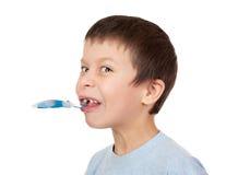 Grimacing chłopiec portret na bielu Obrazy Stock