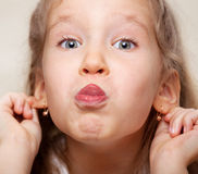 Grimacing child Royalty Free Stock Photo