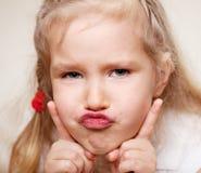Grimacing child Stock Image