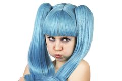 Grimacing  cute woman in blue wig Stock Images