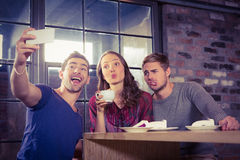 Grimacing friends taking selfies Stock Photography