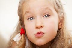 Grimacing girl Stock Photos
