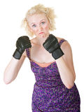 Grimacing Lady with MMA Gloves. Funny European female holding up fists on isolated background royalty free stock images