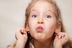 Grimacing little girl Royalty Free Stock Images