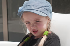 Grimacing little girl Stock Photography