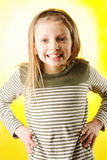 Grimacing little girl Stock Images