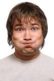 Grimacing man Stock Image