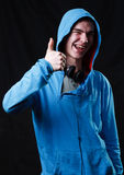 Grimacing teenager in hood Stock Photography