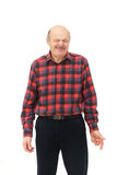 Grimacing from the unpleasant sensation or sound. Elderly man's face wrinkled due to sour taste Stock Image