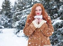 Grimacing woman having discomfort weather, winter outdoor portrait. Grimacing woman having discomfort on winter weather, outdoor portrait Stock Photo