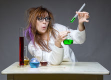 Grimacing working scientist with glass flask Stock Photo
