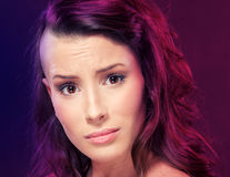 Grimacing young woman. Grimacing young and beautiful woman Royalty Free Stock Images