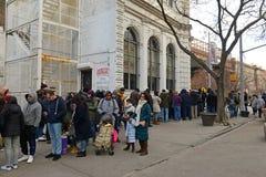 Grimaldi's Pizzeria, Brooklyn, New York. NEW YORK - CIRCA JANUARY 2015. Customers wait on line outside Grimaldi's Pizzeria in Brooklyn, one of New York's Royalty Free Stock Photo