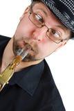 Grimas met saxofoon Royalty-vrije Stock Foto