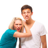 Grimcing couple - very funny. Royalty Free Stock Images