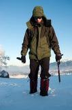 Grimpeur dans la neige photo stock