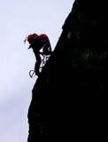 Grimpeur de roche dans les Alpes suisses Photos stock