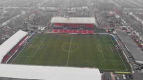 Grimsby, United Kingdom - March 1, 2019: Aerial view of the Grimsby Town Football Club Stadium named Blundell Park. Typical example of a lower league stock video