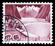 Grimsel Reservoir - type I, Landscapes and technics serie, circa 1949. MOSCOW, RUSSIA - FEBRUARY 10, 2019: A stamp printed in Switzerland shows Grimsel Reservoir royalty free stock photo