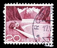 Grimsel Reservoir - type I, Landscapes and technics serie, circa 1949. MOSCOW, RUSSIA - FEBRUARY 10, 2019: A stamp printed in Switzerland shows Grimsel Reservoir stock photos