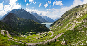 Grimselpass panorama. Panoramic view down the Grimselpass in Switserland, with the road leading down to the lake reservoir Stock Photography