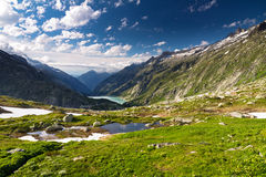Grimselpass view. Scenic view down the Grimselpass in Switserland, as seen from the top Stock Photography