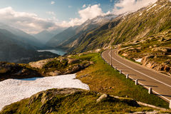 Grimselpass view of road, Alps, Raterichsbodensee Royalty Free Stock Image