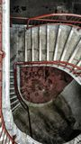 Grimy staircase. A gritty and grimy staircase spirals downwards Royalty Free Stock Photography