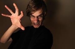Grin diabolico con la mano Fotografie Stock Libere da Diritti