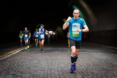 The grin of the marathon athlete. Rome, Italy - April 2nd, 2017: Athletes of the 23rd Rome Marathon to the passage of the tunnel Umberto I, a few kilometers from stock photo