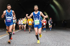 The grin of the marathon athlete Royalty Free Stock Photo