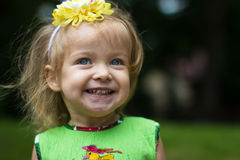 Grin milk teeth. Blue-eyed blonde girl child smiling the entire mouth showing teeth Stock Photo