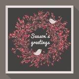 Grinalda do azevinho com os dois pássaros bonitos Imagens de Stock Royalty Free
