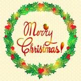 Grinalda do Natal com baga do azevinho Foto de Stock Royalty Free