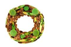 Grinalda do Natal com velas verdes Imagem de Stock
