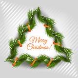 Grinalda do Natal em fundo listrado da luz Fotografia de Stock Royalty Free