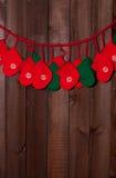 Grinalda do Natal na parede Imagens de Stock Royalty Free