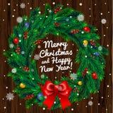 Grinalda do Natal no fundo de madeira Imagens de Stock Royalty Free