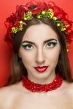 Grinalda vermelha das flores Fotografia de Stock