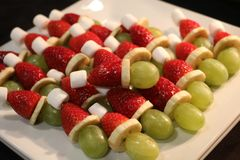 Grinch Santa hats fruit hors d`oeuvres royalty free stock photography
