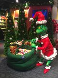 The Grinch Who Stole Christmas. A Store display featured a life size Grinch Who Stole Christmas figure with a bag full of items customers can purchase.  Figure Royalty Free Stock Photos